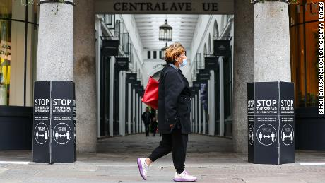 A pedestrian wearing a protective face mask passes an entrance to Covent Garden Market in London, U.K., on Saturday, July 4, 2020. Restaurants, hotels, cinemas and hairdressers will also be allowed to open their doors again on what has been dubbed 'Super Saturday' after 3 1/2 months of an economic lockdown brought in to contain the outbreak. Photographer: Simon Dawson/Bloomberg via Getty Images