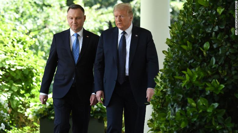 US President Donald Trump walks with his Polish counterpart Andrzej Duda before a press conference at the White House last month.