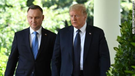 US President Donald Trump and Polish President Andrzej Duda(L) walk before a holding a joint press conference in the Rose Garden of the White House in Washington, DC, June 24, 2020.