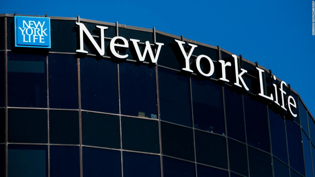 A logo sign outside of a New York Life Insurance Company building.