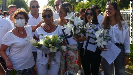 Veronique Monguillot, second left, mourns the death of her late husband Philippe on July 8 in Bayonne.