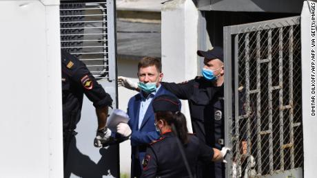 Khabarovsk Governor Sergey Furgal is escorted into a police van after a court hearing in Moscow on Friday.
