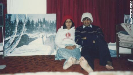 My parents at their first home in the US in 1986, wearing hats my mom knitted.