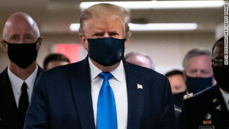 Trump gives in to the mask but takes new risks with schools