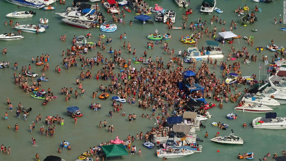 Hundreds of individuals celebrated the July four weekend at a Michigan lake. Now some have Covid-19 - CNN thumbnail