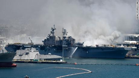 Federal firefighters continue to battle the blaze aboard the Navy ship.