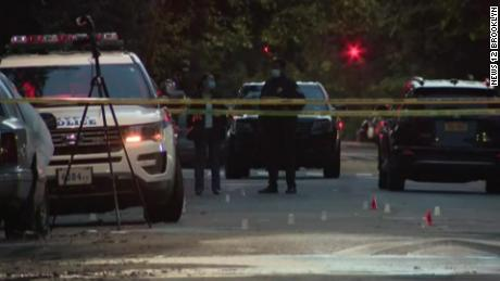 Police respond to the scene of the shooting near a New  York City park on Sunday.