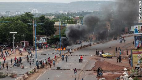Protesters burn tires and barricade roads in the capital Bamako on Friday.