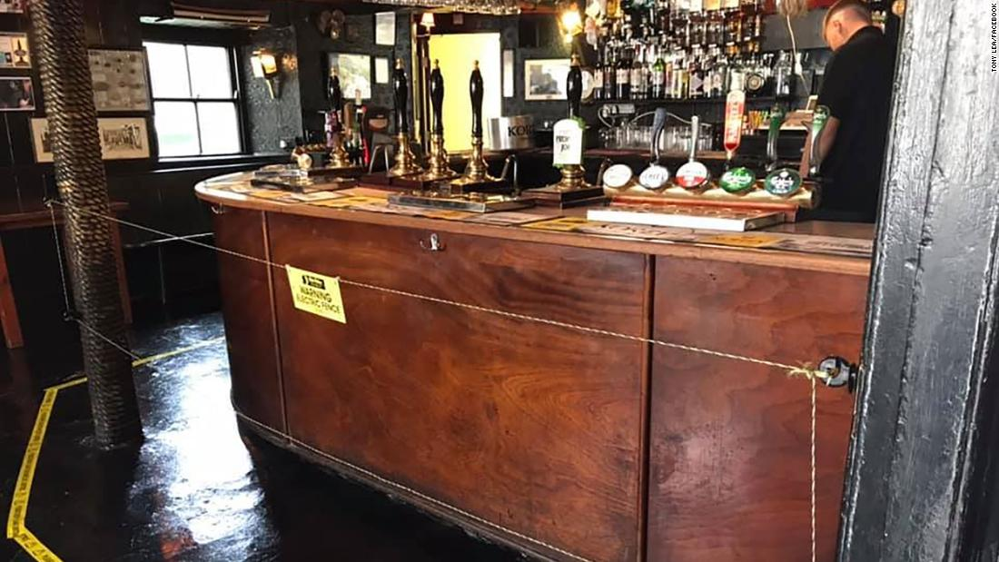English pub owner installs electric fence to keep customers at a safe distance