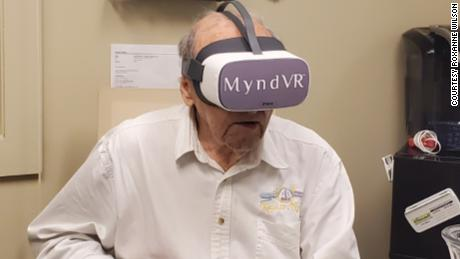 Richard Merrill using the MyndVR virtual reality system.