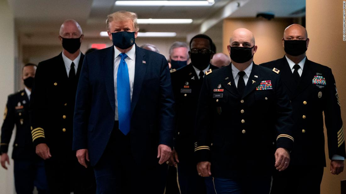 "US President Donald Trump wears a face mask <a href=""https://www.cnn.com/2020/07/11/politics/trump-walter-reed-visit-mask/index.html"" target=""_blank"">as he visits Walter Reed National Military Medical Center</a> in Bethesda, Maryland, on July 11. This was the first time since the pandemic began that the White House press corps got a glimpse of Trump with a face covering."
