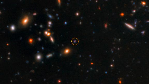 The afterglow of short gamma ray burst that was detected 10 billion light-years away is shown here in a circle. This image was taken by the Gemini-North telescope.