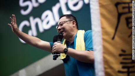 Hong Kong activist and protest leader Benny Tai waves to the crowd during a rally in July 2015.