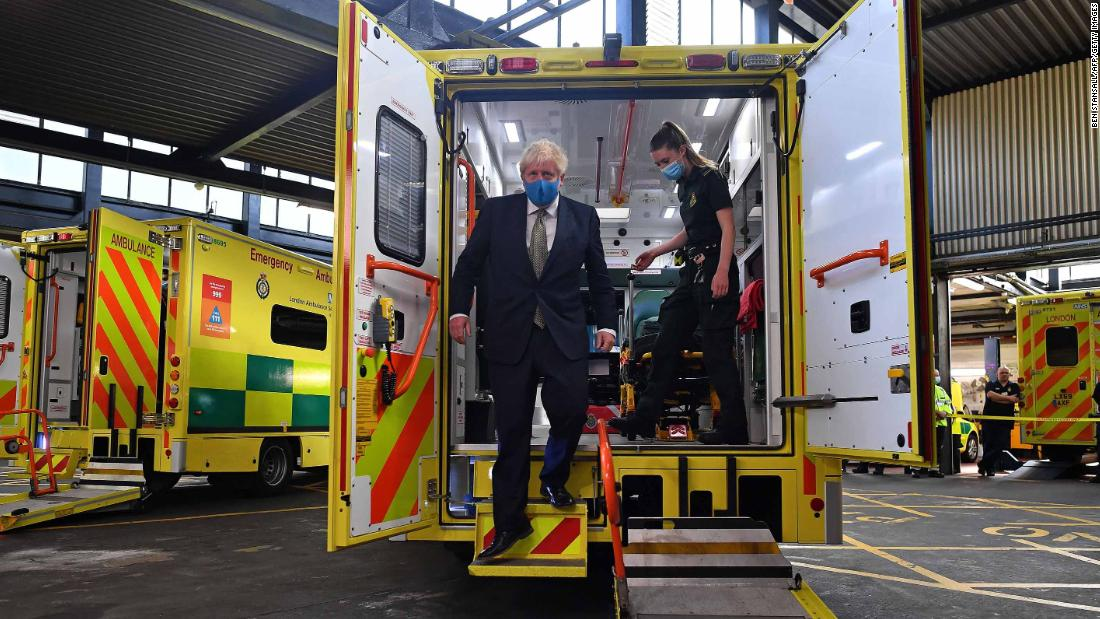 "British Prime Minister Boris Johnson talks with a paramedic during his visit to the headquarters of the London Ambulance Service NHS Trust on July 13. <a href=""https://www.cnn.com/2020/07/14/uk/uk-masks-shops-winter-predictions-intl-scli-gbr/index.html"" target=""_blank"">Wearing face masks</a> in shops and supermarkets in England will be compulsory from July 24. The United Kingdom is one of the countries worst hit by coronavirus. Its fatalities trail only Brazil and the United States."