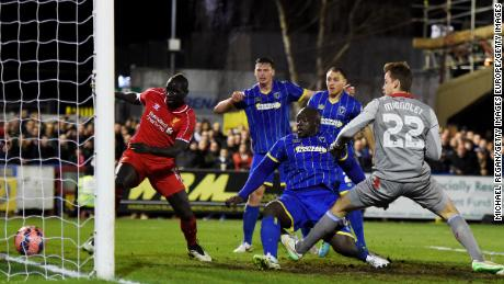 Akinfenwa scores for AFC Wimbledon against Liverpool in the FA Cup in 2015.