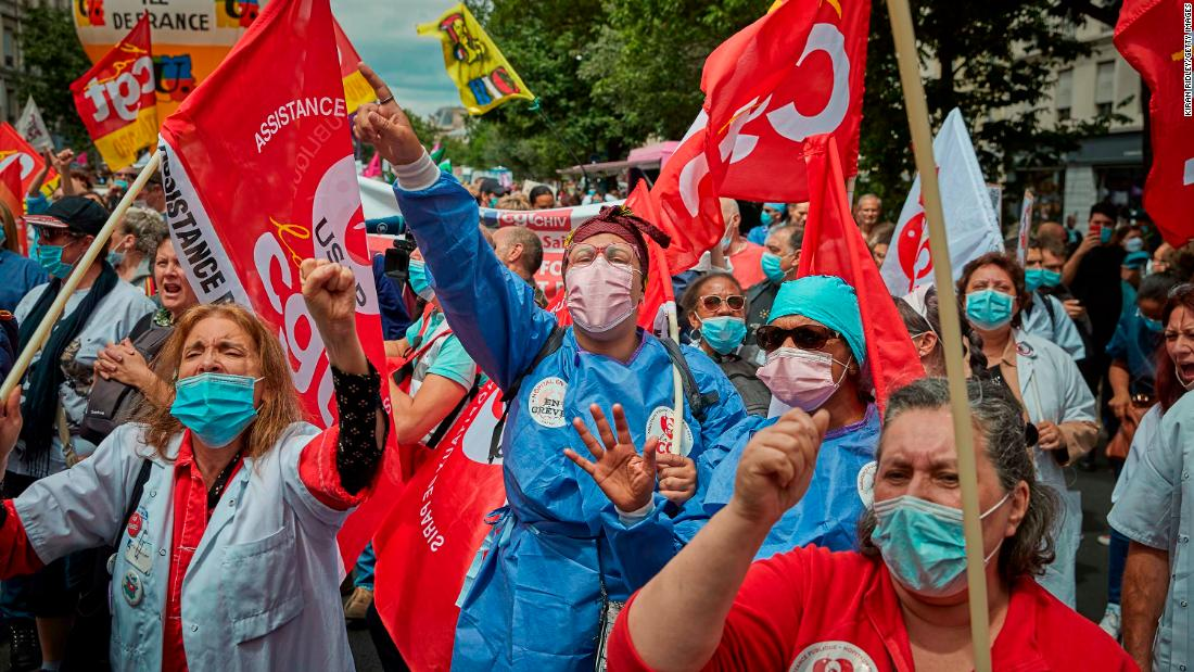 "Health-care workers and union members demonstrate during a Bastille Day protest in Paris on July 14. <a href=""https://www.npr.org/sections/coronavirus-live-updates/2020/07/14/890721869/french-health-care-workers-given-a-raise-honored-on-bastille-day"" target=""_blank"">France is giving health-care workers a raise</a> for their efforts to fight the novel coronavirus."