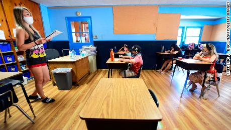 Give teachers 'medical grade PPE' to get schools reopened, pediatrician urges