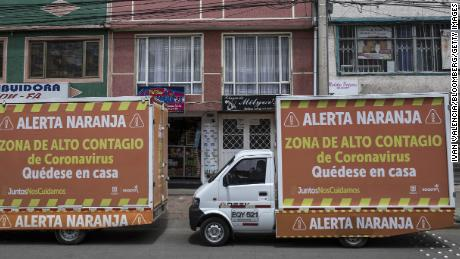 """Orange Alert"" signs are displayed in the Ciudad Bolivar neighborhood of Bogota, Colombia on July 14, 2020. Colombia ranks 5th among Latin America nations for cases of coronavirus."