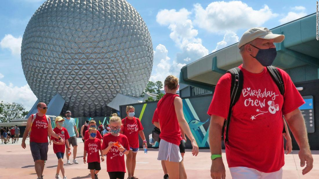 "Guests arrive at Disney's Epcot park in Lake Buena Vista, Florida, on July 15. <a href=""https://www.cnn.com/travel/article/disney-world-epcot-reopens/index.html"" target=""_blank"">The park was reopening,</a> as was Hollywood Studios, for the first time since March 15."