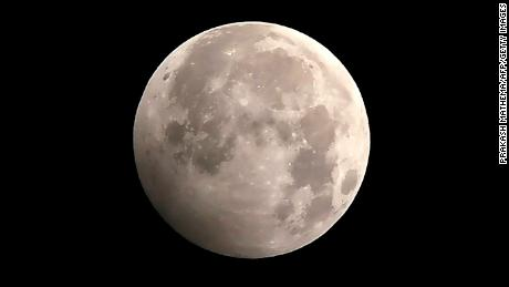 The full moon during the penumbral lunar eclipse is shown here, as seen from Kathmandu on January 11.