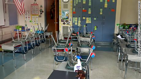 NORWELL, MA - APRIL 21: An empty classroom at the Grace Farrar Cole School in Norwell, MA with a bottle of sanitizer left on a desk on April 21, 2020. Massachusetts Governor Charlie Baker announced that all schools in the state will remain closed for the school year during the COVID-19 pandemic. Spring sports will be cancelled as well. (Photo by David L. Ryan/The Boston Globe via Getty Images)