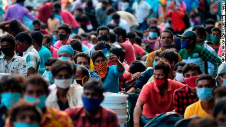 Stranded migrant labourers with their belonging wait to board a special train to Howrah station in Kolkata after the government eased a nationwide lockdown in Chennai on July 9, 2020.