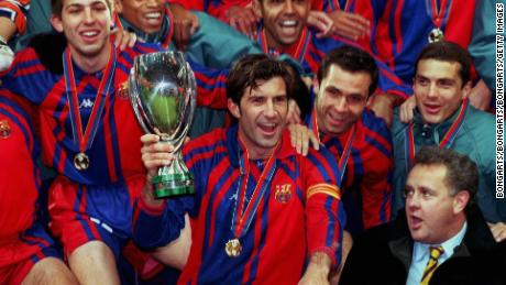 Figo celebrates winning the Super Cup with Barcelona in 1998.