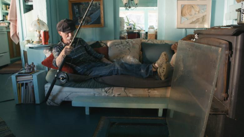Thanks to a piece of Plexiglass in their living room, Adams is able to fish from the comfort of his couch.