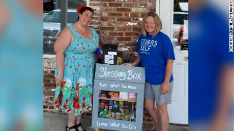 Mandy Stewart and Amanda Browning with the blessing box.