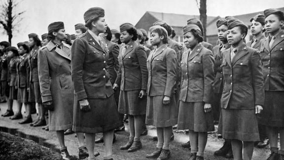 A US, major of Women's Army Corps inspects newly-arrived Black WACs troops at a temporary post in England (February 1945). (Photo by Photo12/UIG/Getty Images)