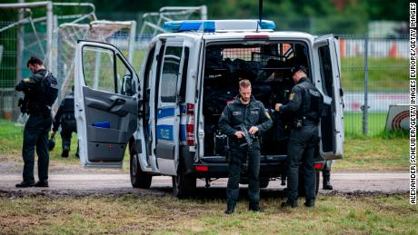 Armed police officers are seen during the ongoing manhunt for fugitive Yves Rausch on July 17 in Oppenau, Germany.