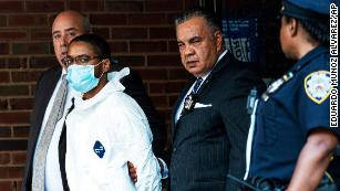 Tyrese Haspil, 21, is escorted by NYPD detectives on Friday.