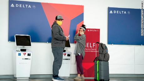 Delta Air Lines announces new health screenings for passengers who can't wear masks and asks them to consider staying home