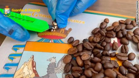 Coffee beans in the shipment had been hollowed out and filled with cocaine, Italian police say.