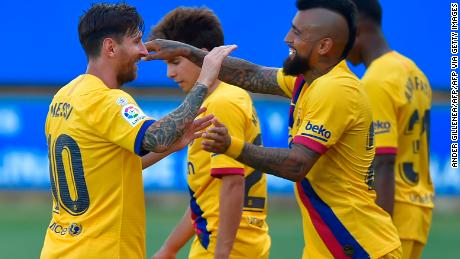 Messi (L) celebrates his second goal with teammates.