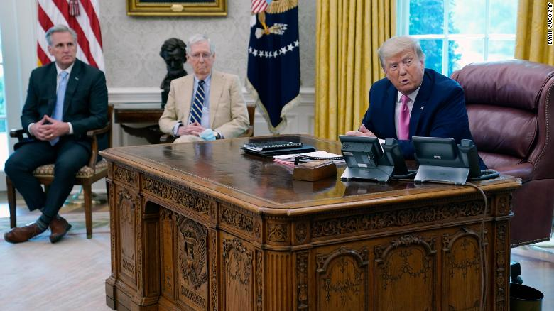 President Donald Trump meets on Monday morning with Senate Majority Leader Mitch McConnell, center, and House Minority Leader Kevin McCarthy in the Oval Office at the White House in Washington.