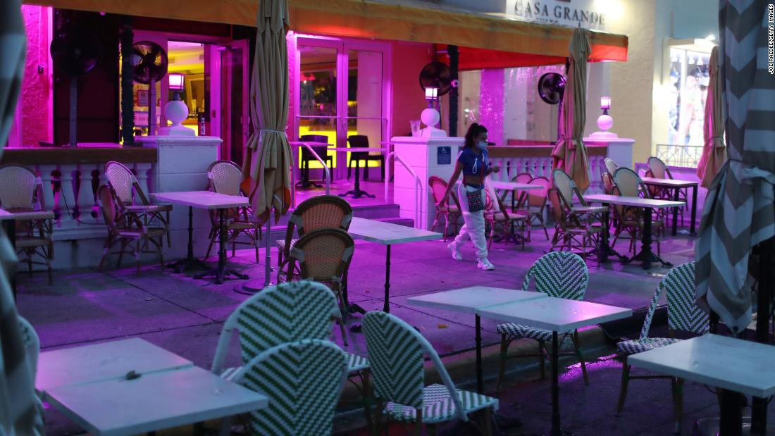 "A restaurant's outdoor seating area is closed in Miami Beach, Florida, on July 18. The city ordered <a href=""https://edition.cnn.com/world/live-news/coronavirus-pandemic-07-17-20-intl/h_9581f7656c9969cf26c2a626790f86be"" target=""_blank"">a curfew for most of its entertainment district.</a>"