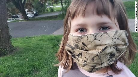 Emmy Ranno, 7, wears her mask.