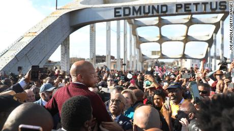 US Rep. John Lewis speaks to the crowd at the Edmund Pettus Bridge crossing reenactment on March 1, 2020, in Selma, Alabama.