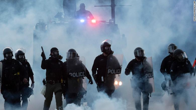 Police officers launch tear gas canisters at protesters in Detroit during a demonstration over the death of George Floyd in Minneapolis on Sunday, May 31, 2020.