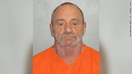 Earl Wilson has been charged with murder in connection with a killing in Oklahoma in 1985.