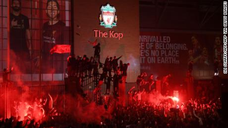 Fans celebrate Liverpool's Premier League title outside Anfield stadium in Liverpool last month.