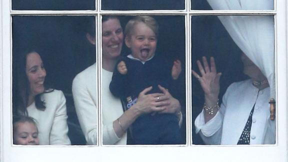 Prince George is held by his nanny, Maria Teresa Turrion Borrallo, during the Trooping the Colour ceremony in June 2015.