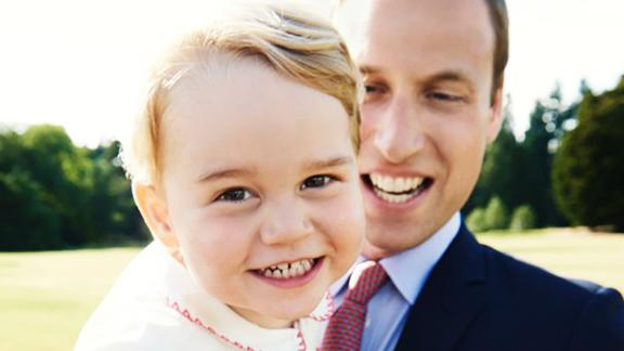 Prince George is held by his father a day before his second birthday in July 2015.