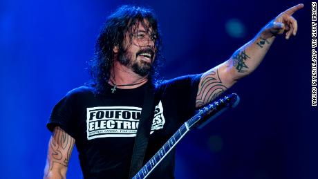 US singer and guitarist Dave Grohl of the Foo Fighters performs onstage during the Rock in Rio festival at the Olympic Park, Rio de Janeiro, Brazil, on September 28, 2019.