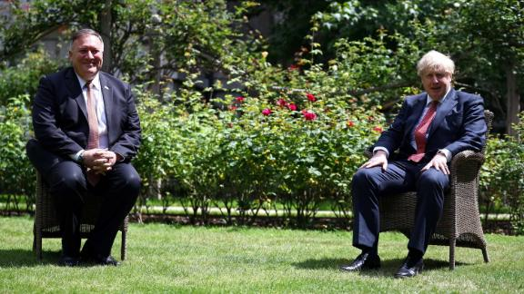 US Secretary of State Mike Pompeo sits across from Johnson in the garden of No. 10 Downing Street in July 2020.
