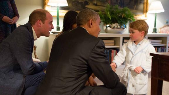Prince George shakes hands with US President Barack Obama while Obama visited Kensington Palace in April 2016.