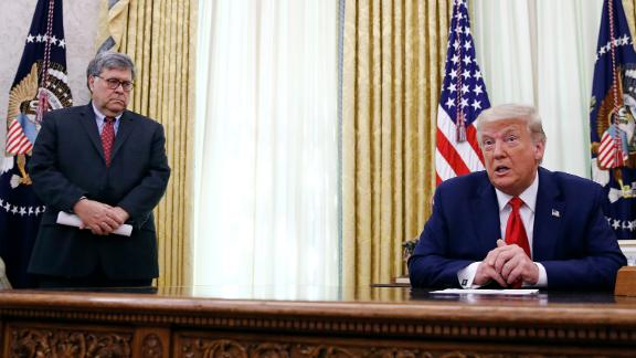President Donald Trump speaks alongside Attorney General William Barr during a a law enforcement briefing on the MS-13 gang in the Oval Office of the White House, Wednesday, July 15, 2020, in Washington. (AP Photo/Patrick Semansky)