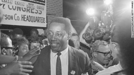 Charles Evers is cheered outside his campaign headquarters after he was elected mayor of Fayette, Mississippi, in 1969.