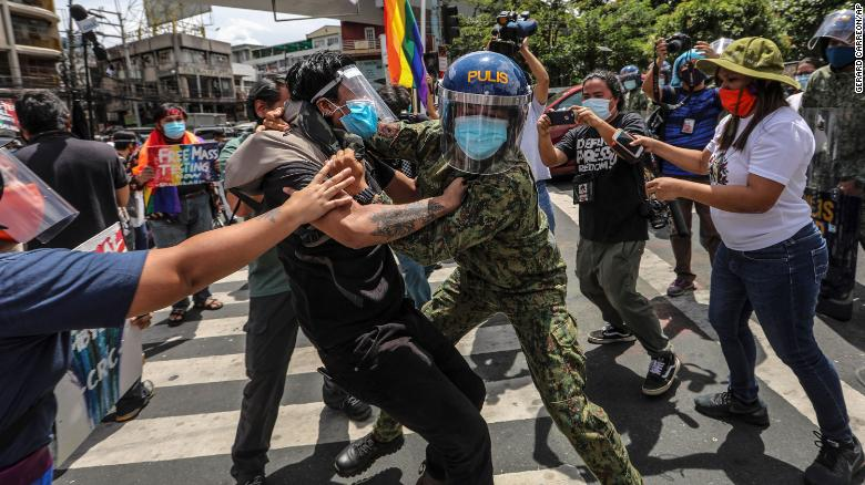 Police clash with protesters during a LGBTQ pride march in Manila, Philippines, on June 26, 2020. Demonstrators were also protesting the country's new anti-terror law.